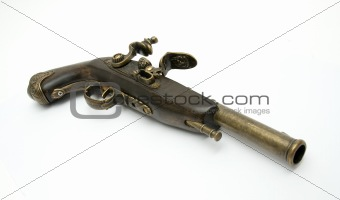 Ancient pistol isolated on a white background