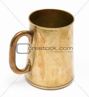 old brass mug isolated on white
