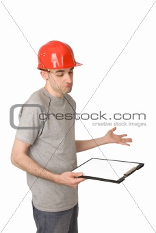 Senior man builder in a red helmet