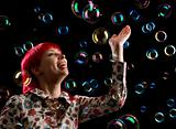 happy woman and soap bubbles