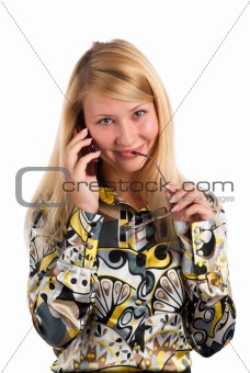 cute young girl talking on mobile phone against white background