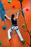 Wioman on climbing wall