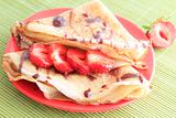 pancakes with strawberries on red plate