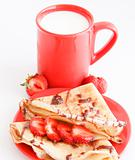 cup of milk and cakes with strawberry