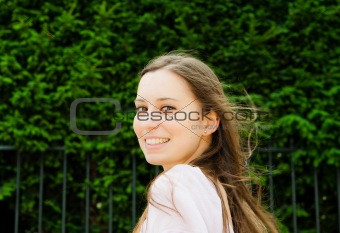 beautiful young woman smiling while looking back