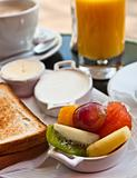 Breakfast with orange juice and fresh fruits