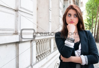 beautiful young woman outdoors portrait of thinking woman