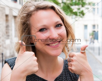 smiling beautiful happy woman with thumbs up