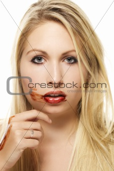 beautiful blonde woman after eating chocolate