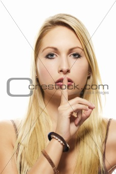 beautiful blonde woman holding finger at her mouth