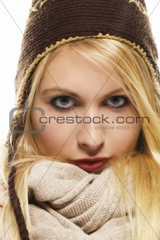 beautiful blonde woman in winter dress