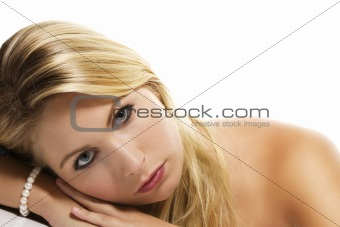 beautiful blonde woman laying her head on a table