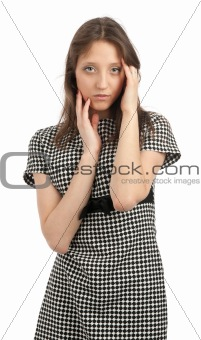 Portrait of a young girl touching her face with hands