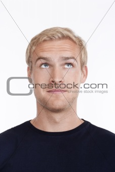 portrait of a young man with blond hair looking up - isolated on white