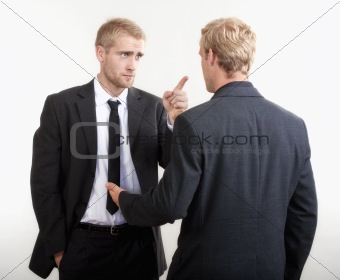ywo you businessmen standing, discussing, arguing - isolated on light gray