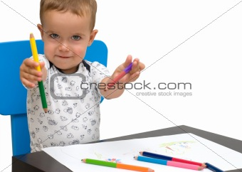 Little boy and pencils