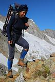 Young woman trekking in the mountains