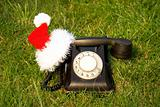 Old fashioned black telephone with Santa's hat