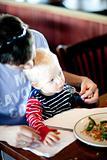 father feeding his son