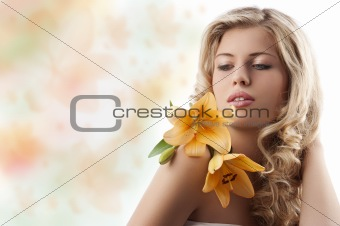blond curly girl with orange flower