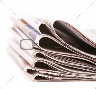 Pile of newspapers isolated over white background