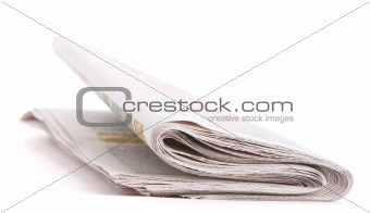 Folded morning newspaper isolated over white background