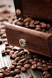 Coffee beans in the rustic old grinder