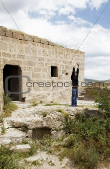 Trendy teenager sun worshipping church wall Turkey