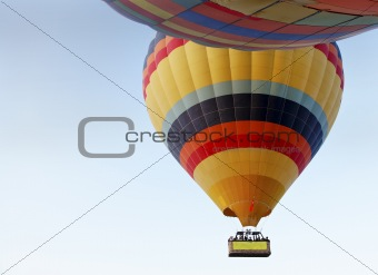 abstract two hot air balloons light blue sky