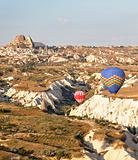 low flying balloons in ravine Uchisar Turkey
