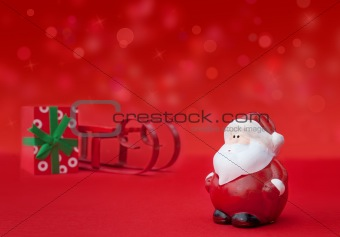 Santa Claus with sledge and present