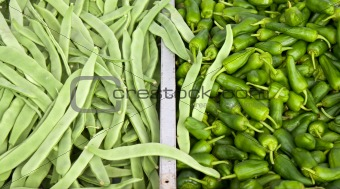 Pile of french beans and jalapeno peppers