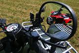 Red quad bike in rear view mirror
