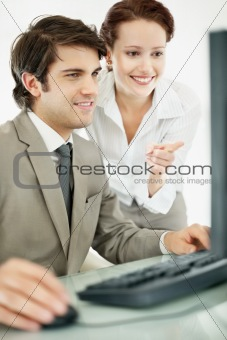 Business people working together on the computer