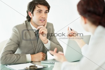 Successful young business man taking an interview
