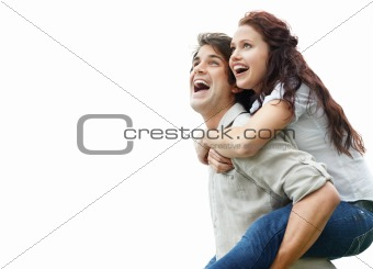 Young couple enjoying a piggy back ride