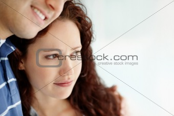 Cute thoughtful woman with a man