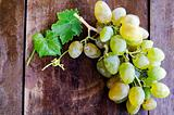 Ripe grapes on wooden background