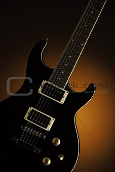 Black Electric Guitar on Orange
