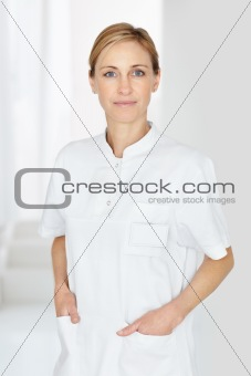 Female nurse standing with hands in pocket