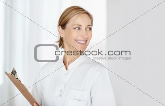 Smiling female nurse with a notepad