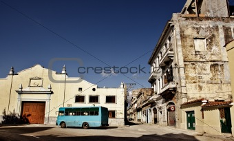 Blue bus on an empty square