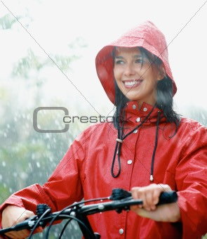 Woman on bike in rain