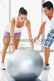 Woman doing push ups on exercise ball