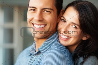 Closeup of cheerful young couple smiling