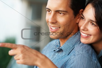 Young smiling woman showing something