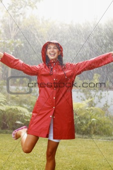 Portrait of happy woman in red raincoat