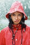 Closeup portrait of pretty woman in rain