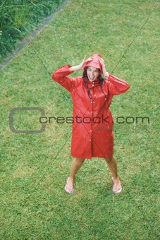 Pretty woman in raincoat enjoying