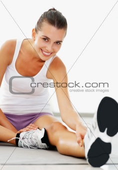 Active young woman stretching her legs